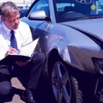 Man inspects car paint damage